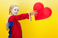 Cute girl clown giving red heart valentine mothers day Stock Photos