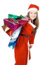 Cute girl dressed as Santa brings gifts Royalty Free Stock Image