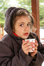 Cute girl drinks coffee in cold weather Stock Images