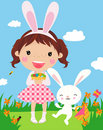 Cute girl with easter bunny and decorated eggs. Stock Image