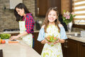 Cute girl eating healthy at home Royalty Free Stock Photo