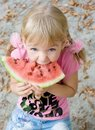 Cute girl eating watermelon. Royalty Free Stock Photography