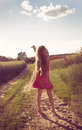 Cute girl enjoying nature girl over sun little Royalty Free Stock Image