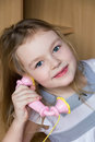 Cute girl five years old portrait of beautiful with pink telephone Royalty Free Stock Photo