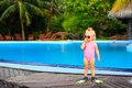 Cute girl with flippers in swimming pool at beach tropical Royalty Free Stock Images