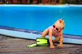 Cute girl with flippers in swimming pool at beach tropical Royalty Free Stock Photo