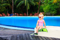 Cute girl with flippers in swimming pool at beach tropical Stock Images