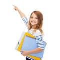 Cute girl with folders pointing at virtual screen education school and concept little colorful in the air or Stock Image