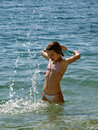 Cute girl in fun with sea drops Royalty Free Stock Images