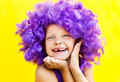 Cute girl in funny wig lovely a purple showing happy emotions Stock Image