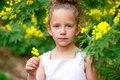 Cute girl in garden with flowers. Royalty Free Stock Photography