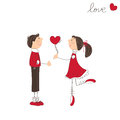 Cute girl give heart to the boy Royalty Free Stock Images