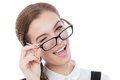 Cute girl with glasses winks at the camera. Copy space available Royalty Free Stock Photo