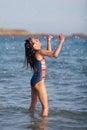 Cute girl has fun in the sea water Royalty Free Stock Photo