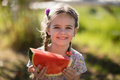 Cute girl having a watermelon slice in park Royalty Free Stock Photo