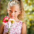 Cute girl holding flowers. Royalty Free Stock Photos