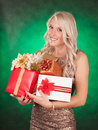 Cute girl holding gifts blond bunch of christmas Royalty Free Stock Photo