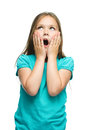 Cute girl is holding her face in astonishment and looking up isolated over white Royalty Free Stock Photos