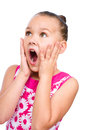 Cute girl is holding her face in astonishment and looking up isolated over white Royalty Free Stock Images