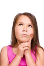 Cute girl is holding her face in astonishment and looking up isolated over white Royalty Free Stock Photography