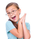 Cute girl is holding her face in astonishment and looking up isolated over white Royalty Free Stock Photo
