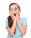 Cute girl is holding her face in astonishment and looking up isolated over white Stock Images