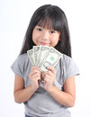 Cute girl holding money with white background Royalty Free Stock Photography