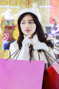 Cute girl holds christmas shopping bags picture of beautiful teenage carrying at the mall while wearing winter coat Stock Photo