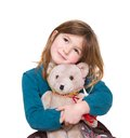 Cute girl hugging teddy bear close up portrait of a on isolated white background Stock Images