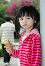 Cute girl with ice scream little in her hand Stock Photography