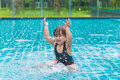 Cute girl or little child playing in swimming pool happily Royalty Free Stock Photo