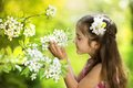 Cute girl little is holding flower outside in the green park Stock Image