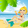Cute girl lying on a sun lounger on the beach with cocktail Royalty Free Stock Photo