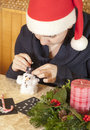 Cute girl making cotton-wool snowman Stock Image