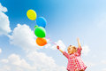 Cute girl with many balloons on sky background Royalty Free Stock Photo