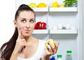 Cute girl near the open refrigerator Stock Photo