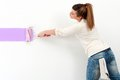 Cute girl painting the wall. Stock Photography