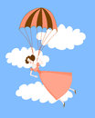 Cute girl in a pink dress flying on a parachute. Blue sky