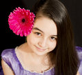 Cute girl with pink flower Royalty Free Stock Image