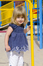 Cute girl in a playground Royalty Free Stock Image
