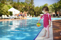 Cute girl playing in swimming pool Royalty Free Stock Photo