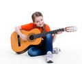 Cute girl plays on the acoustic guitar with bright emotions isolated white background Royalty Free Stock Photo