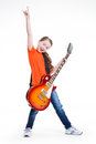 Cute girl plays on the electric guitar with bright emotions isolated white background Stock Photography