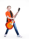 Cute girl plays on the electric guitar with bright emotions isolated white background Stock Photo