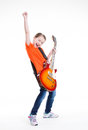 Cute girl plays on the electric guitar with bright emotions isolated white background Royalty Free Stock Photography