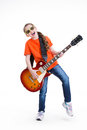 Cute girl plays on the electric guitar with glasses isolated white background Royalty Free Stock Images