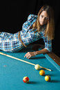 Cute girl on pool table Royalty Free Stock Photo