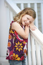 Cute Girl At Porch Railing Royalty Free Stock Photo