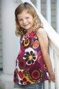Cute Girl At Porch Railing Royalty Free Stock Photo