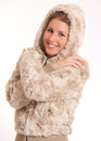 Cute girl prepared for cold weather with a fury winter outfit and the hood on Royalty Free Stock Photography
